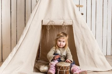young girl in a tent